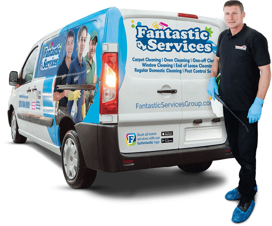 A Fantastic pest control expert in Melbourne standing in front of a branded van